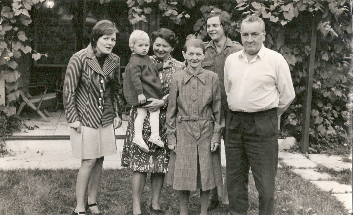 With mom and her mom, father, brother and grandma
